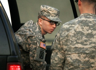 Bradley Manning is escorted from a security vehicle to a courthouse in Fort Meade in Maryland on Monday