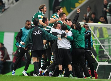 The Sporting players celebrate Xandao's goal.