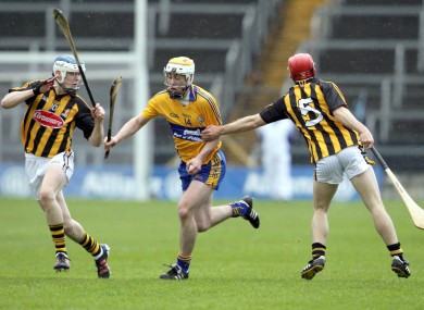 Clare's Conor McGrath with Tommy Walsh and TJ Reid of Kilkenny