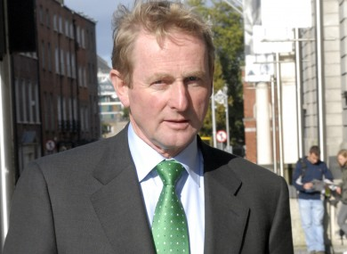 Enda Kenny, pictured here outside Leinster House on the day after the Fianna Fáil-led government said it would be guaranteeing the country's banks.