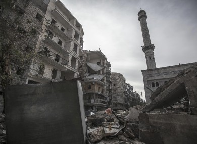 A mosque minaret still stands amid rubble from damaged buildings after an aircraft strike hit the mosque one week ago in the Tarik Al-Bab neighborhood, southeast of Aleppo, Syria
