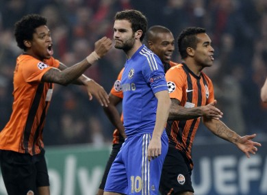 Alex Teixeira of Shakhtar Donetsk, right, celebrates in front of Juan Mata.