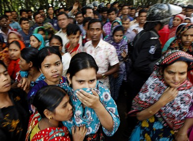 Outside the fire-shattered garment factory in Dhaka, Bangladesh where over 100 people died at the weekend.