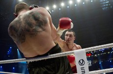 Going the distance: Klitschko sees off Wach to retain world titles