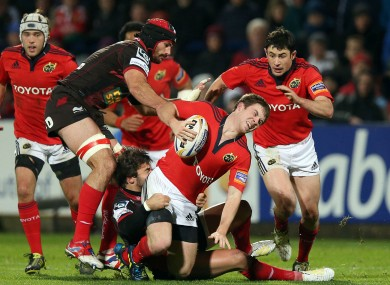 Munster's Luke O'Dea tackled by Gareth Owen of Scarlets.