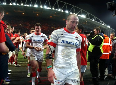 Steve Borthwick leaves the pitch at Thomond Park after his side's defeat.