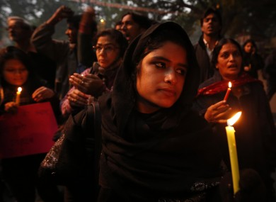 Participants at a candlelit vigil for the gang-rape victim yesterday