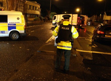 Police at the scene of the booby-trapped car in east Belfast on Sunday.