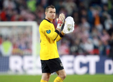 A dejected Shay Given applauds the Irish supporters in Poznan.