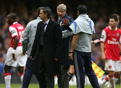 Arsenal manager Arsene Wenger tries to speak with Jose Mourinho when he was Chelsea manager.