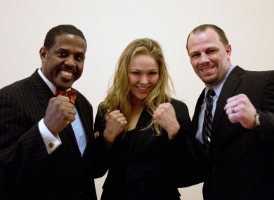 Ronda Rousey, center, and Nick Catone pose with Brooklyn senator Kevin Parker.