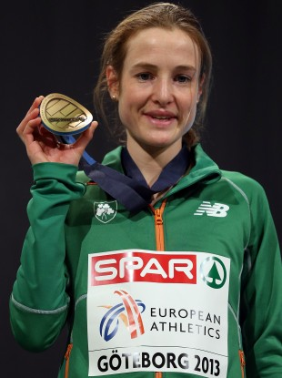 Britton is presented with her bronze medal.