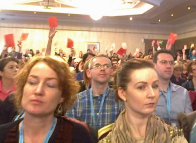 Red cards were held up as Minister Quinn began his address this morning.