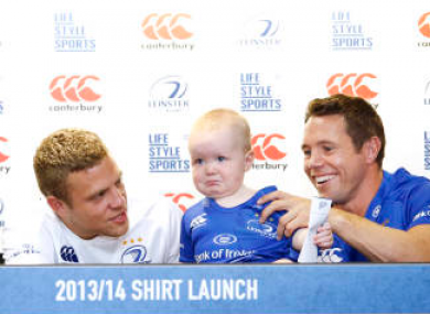 Ian Madigan tries to comfort Fionn Kelly as Isaac Boss signs his jersey.