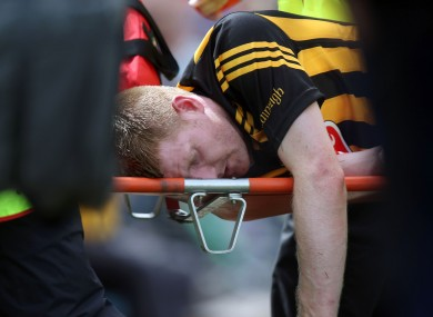 Kilkenny's Richie Power leaves the field on a stretcher.