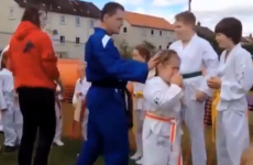 Taekwon-Do instructor kicks board into little girl's face