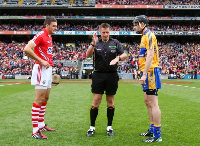 Cork's Patrick Cronin and Patrick Donnellan of Clare with referee Brian Gavin at the coin toss ahead of the first game.