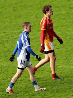 Tommy O'Reilly (in the blue of Breaffy) and Eoghan O'Reilly (in the red of Castlebar Mitchels).