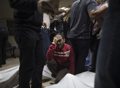 A supporter of Egypt's ousted President Mohammed Morsi mourns a relative killed during clashes with security forces