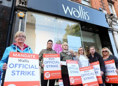 Wallis workers on strike stand outside the Wallis Shop on Grafton street