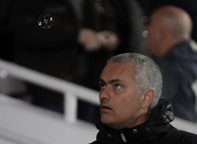 Mourinho eyes up a bubble at Upton Park last weekend.