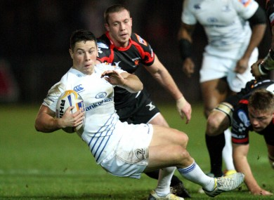 John Cooney is tackled by Dragon's Richie Rees.