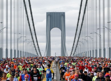 Runners cross the Verrazano-Narrows Bridge at the start of the New York City Marathon on Sunday morning.