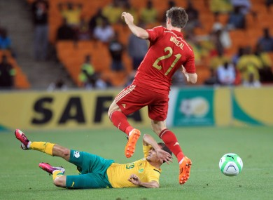 South Africa's Daylon Claasen, bottom, defends against Spain's Ignacio Monreal.