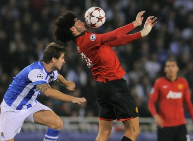 Manchester United's Marouane Fellaini duel for the ball with Real Sociedad's Inigo Martinez.