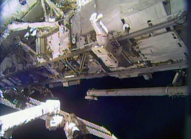 Rick Mastracchio works outside the International Space Station during the first of a series of spacewalks to replace a degraded ammonia pump module.