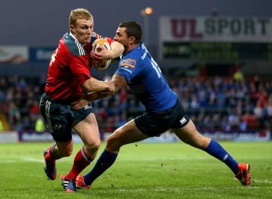 Keith Earls evades Rob Kearney earlier this season at Thomond Park.