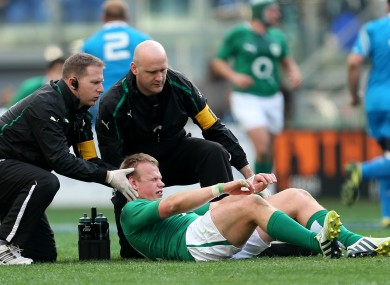 Luke Marshall is assessed for concussion during Ireland's loss to Italy in March.