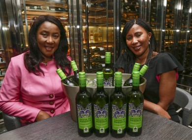 Nelson Mandela's daughter, Makaziwe Mandela, left, and his granddaughter Tukwini Mandela pose with some of their House of Mandela wines.