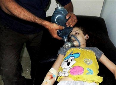 A girl is treated for injuries inflicted by chemical weapons on 21 August in Ghouta.