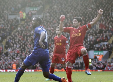 Liverpool's Luis Suarez (right) scores his team's third goal.