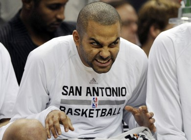 Tony Parker makes faces on the bench during the second half of an NBA preseason game in October.