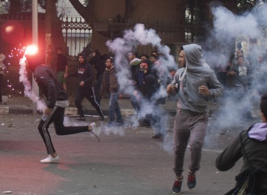 Egyptian anti-military protesters, mostly supporters of ousted Islamist President Mohammed Morsi, clash with security forces in downtown Cairo