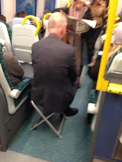 This man has a novel way of ensuring he has a seat on the train