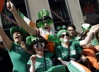 People watch the St Patrick's Day Parade on 5th Avenue in New York City