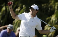 Four share lead at windy WGC, as Rory McIlroy lurks