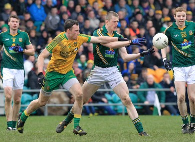Meath's Kevin Reilly and Martin McElhinney of Donegal.