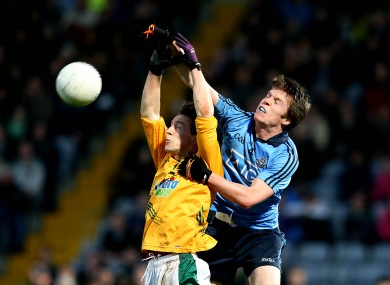 Meath's Bryan McMahon and Robbie McDaid of Dublin.