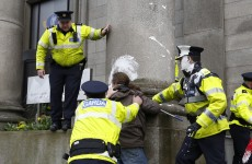 Five appear in court charged over throwing paint at Department of Justice
