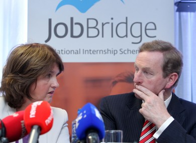 Enda Kenny and Joan Burton at last year's review of the scheme.